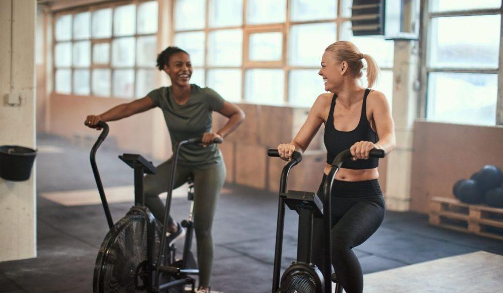 women on stationary bike