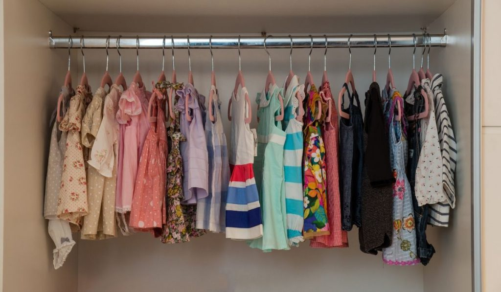 toddler's dresses hangs in the cabinet